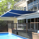 BLUE COMFORT Folding Arm Awning OVER POOL