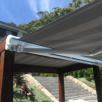 Comfort – Twin Grey and White block Stripe Folding Arm Awning awnings over pool area by Outdoor Aussie-1