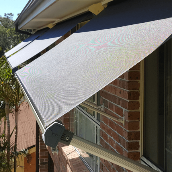 Image Showing three Pivot Arm Awning installed over window in Australia