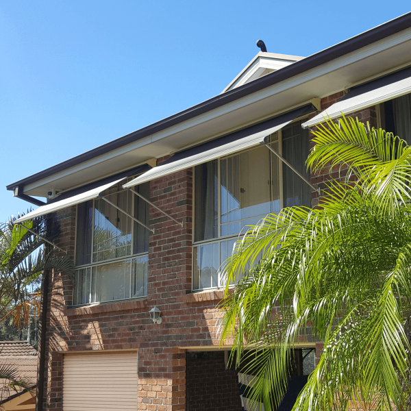system 2000 pivot arm awnings on first floor of residential home