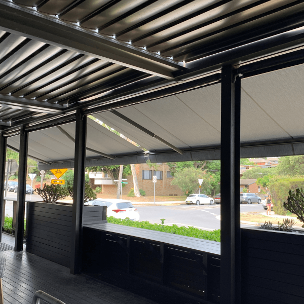Left hand view Comfort Folding Arm Awning view from below with grey fabric docril and grey anthracite powder coat