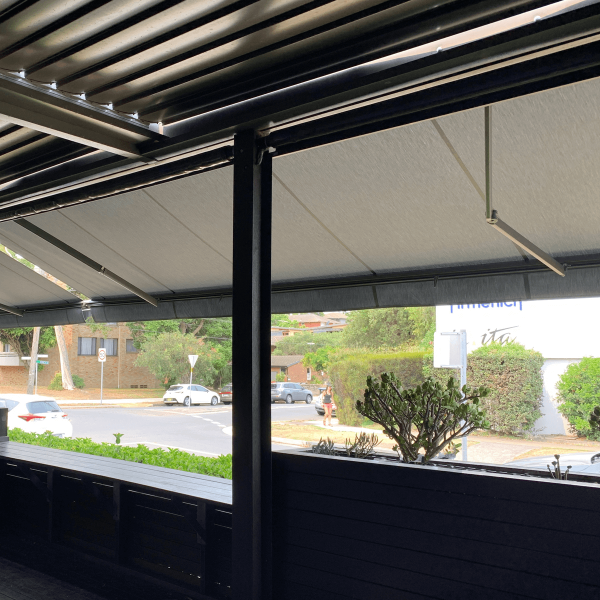 Right hand View from under a Comfort Folding Arm Awning view from below with grey fabric docril and grey anthracite powder coat