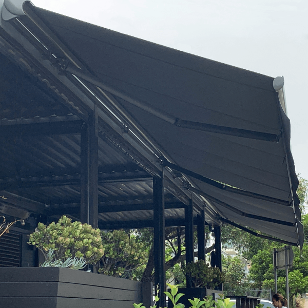 Comfort Folding Arm Awning view from below with grey fabric docril and grey anthracite powder coat