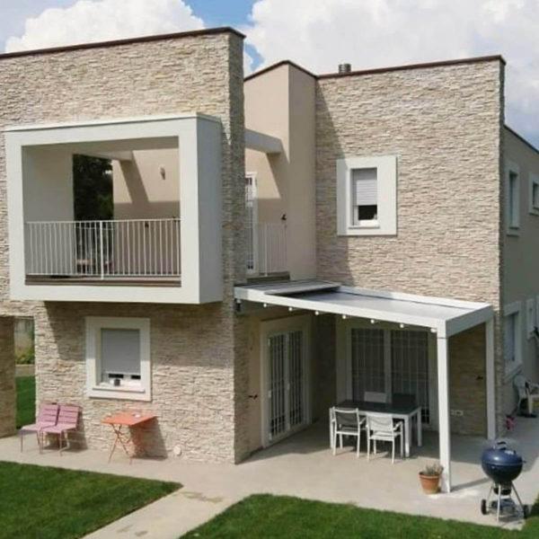 Single Zerro Uniq F installed on architecturally designed stack stone feature home