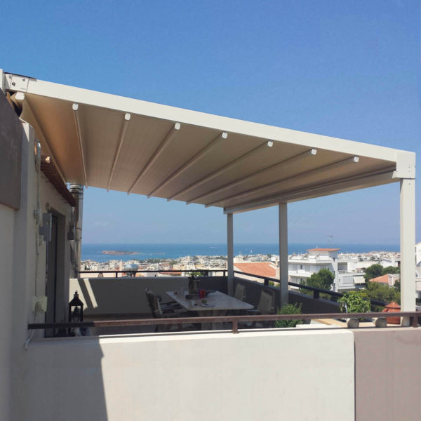 Twin Zerro Uniq F retractable roof overlooking Ocean with cream coloured frame and membrane