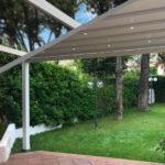 Zerro Retractable Roof in Green Backyard – Retracted – Blue Sky 1.1