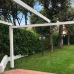 Zerro Retractable Roof in Green Backyard – Retracted – Blue Sky