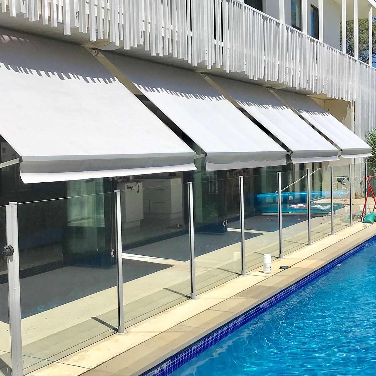 heavy duty robusta pivot arm awnings over pool