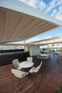 Extended retractable roof system providing shade support posts Alpha Classic Q covered group