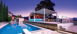 Retractable roof system next to pool with hammock and alfresco area